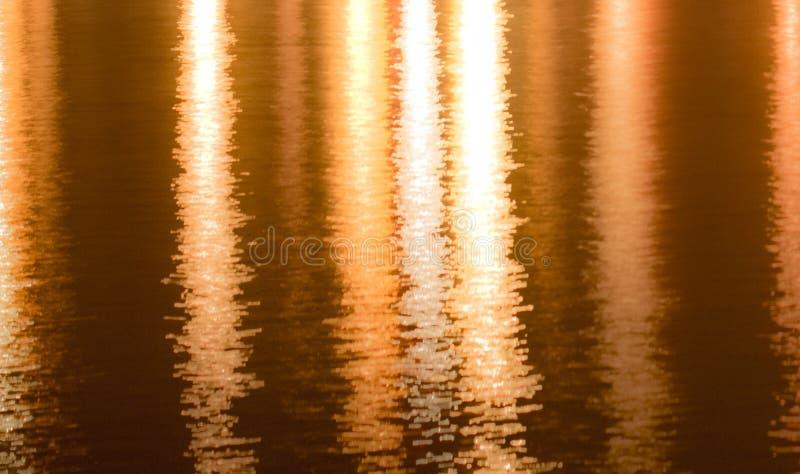 Сияющим предпосылка текстурированная золотом стоковое фото rf