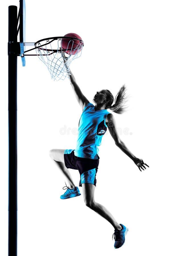 Силуэт баскетболиста женщины стоковые фото