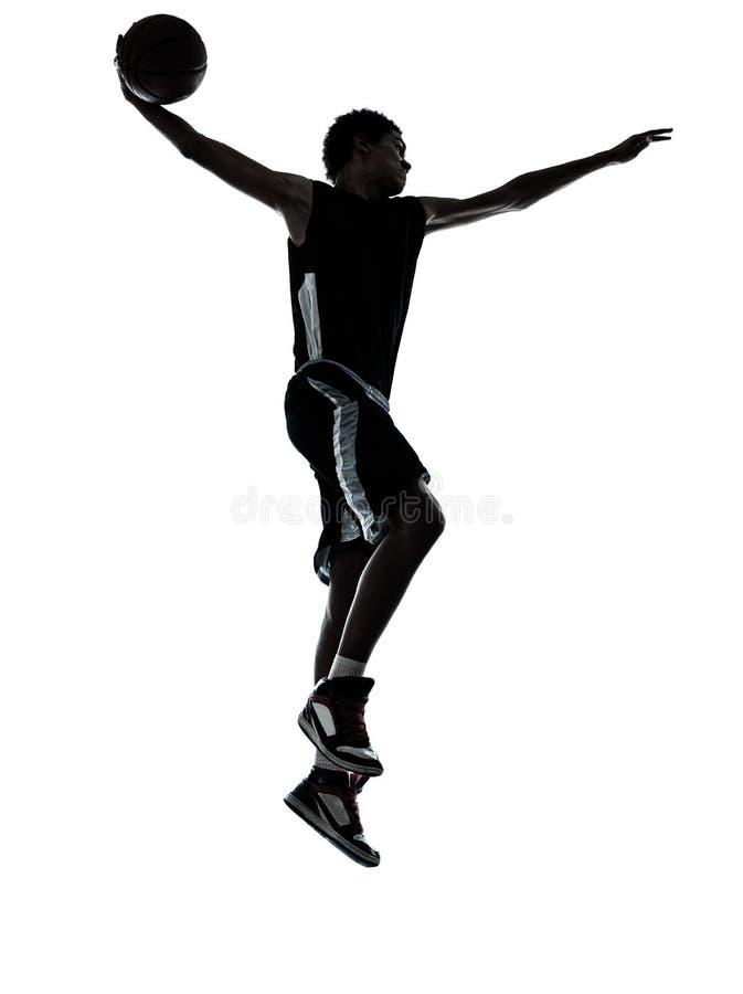 Силуэт баскетболиста dunking стоковые изображения rf