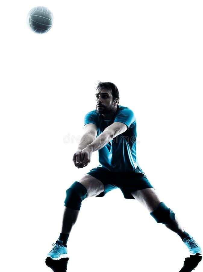 Силуэт волейбола человека стоковые изображения