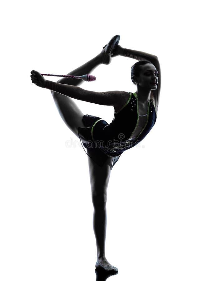 Силуэт девушки teeenager звукомерной гимнастики стоковое изображение