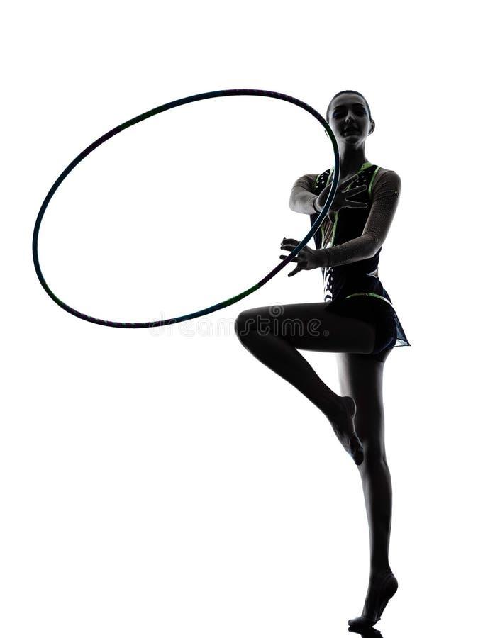 Силуэт девушки teeenager звукомерной гимнастики стоковое изображение rf
