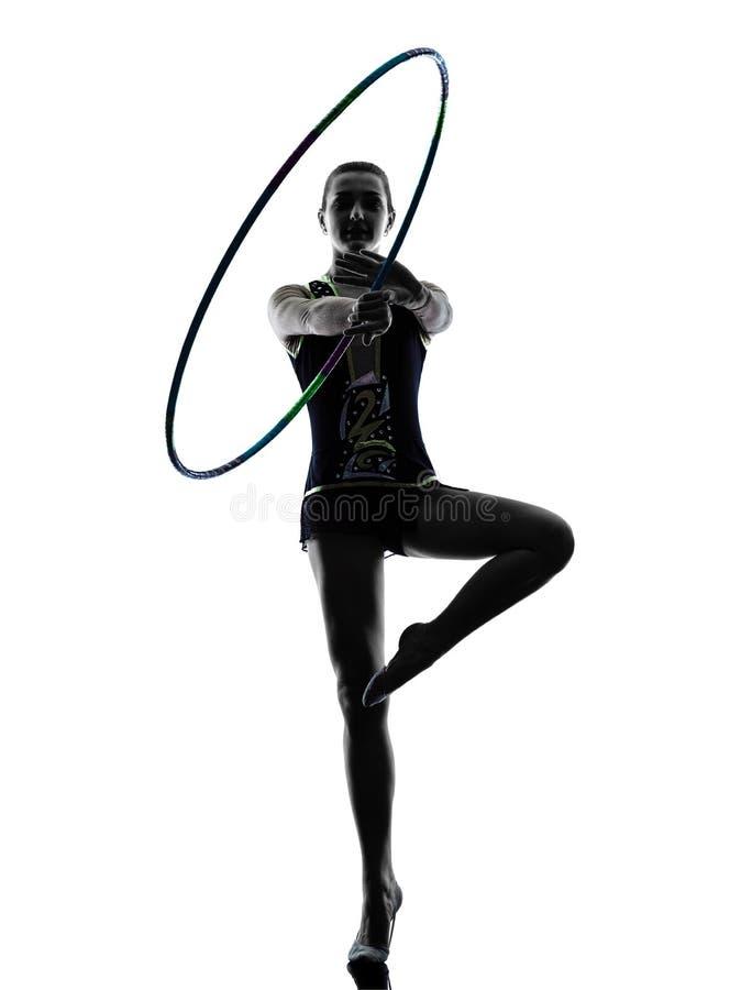 Силуэт девушки teeenager звукомерной гимнастики стоковые фото