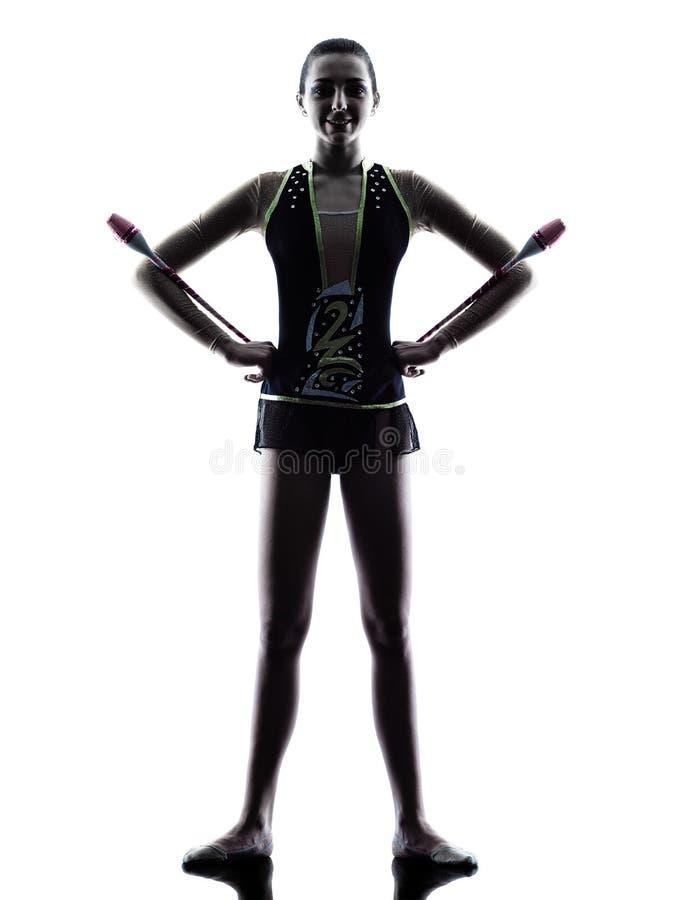 Силуэт девушки teeenager звукомерной гимнастики стоковая фотография