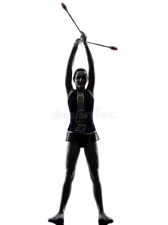 Силуэт девушки teeenager звукомерной гимнастики стоковая фотография rf