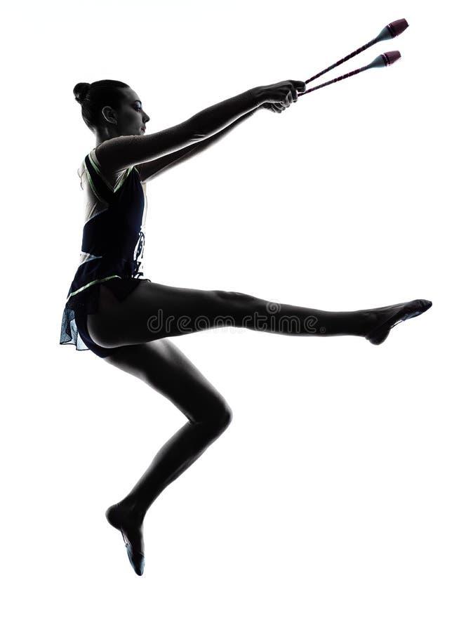 Силуэт женщины девушки teeenager звукомерной гимнастики стоковые изображения