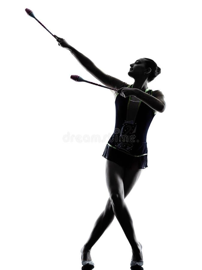Силуэт женщины девушки teeenager звукомерной гимнастики стоковое изображение