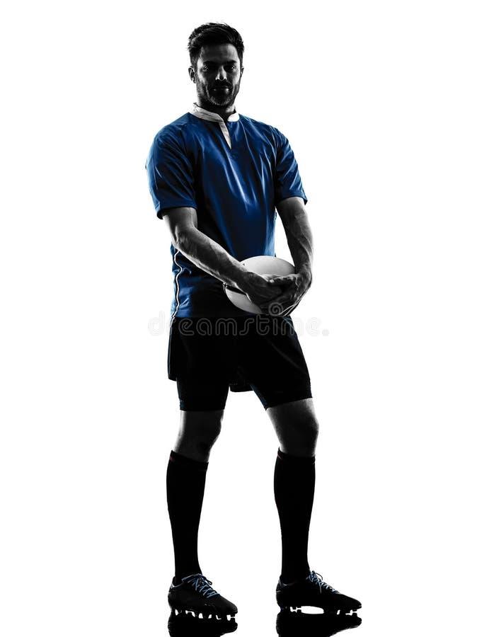 Силуэт игрока человека рэгби стоковое фото rf