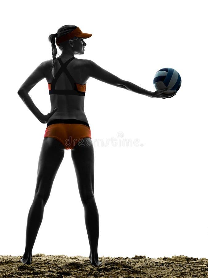 Силуэт игрока шарика пляжного волейбола женщины стоковые фото