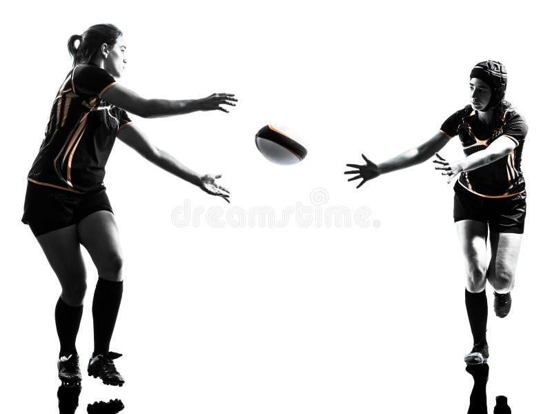 Силуэт игроков женщин рэгби стоковая фотография rf