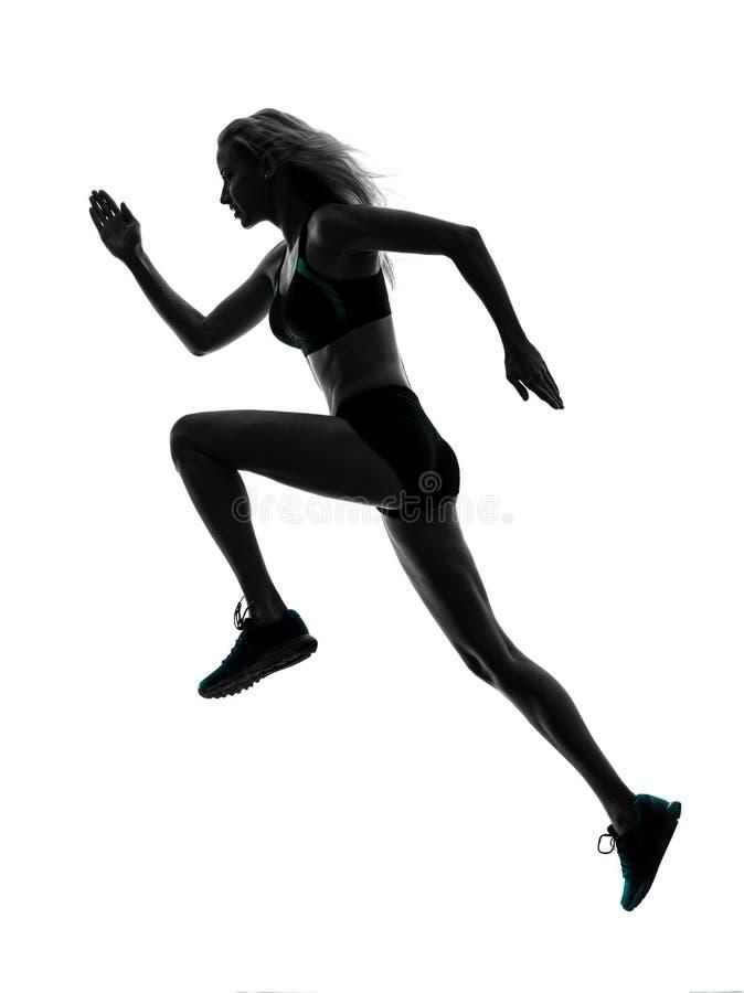 Силуэт идущего jogger бегуна женщины jogging стоковые фото