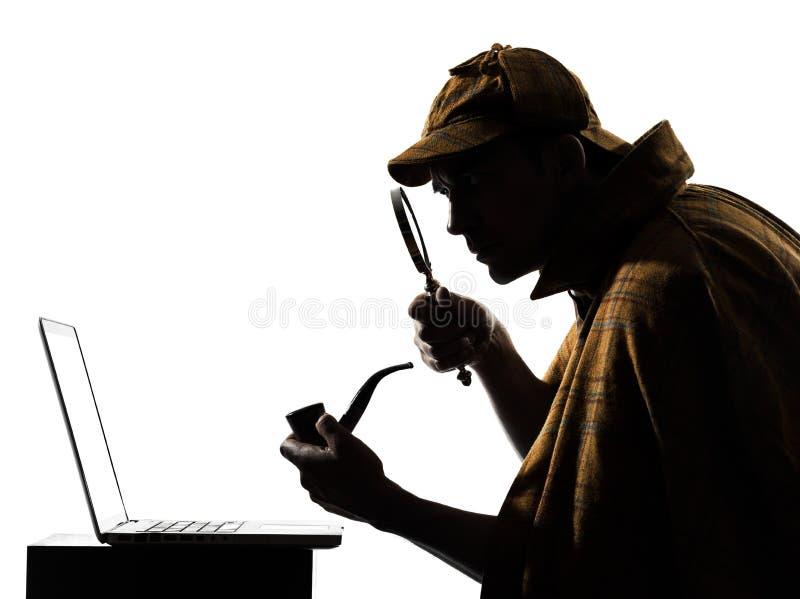 Силуэт портативного компьютера holmes Sherlock стоковая фотография rf