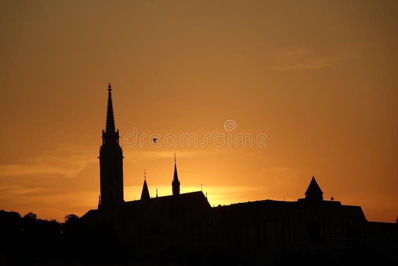 Силуэт района замка Buda во время захода солнца стоковые изображения