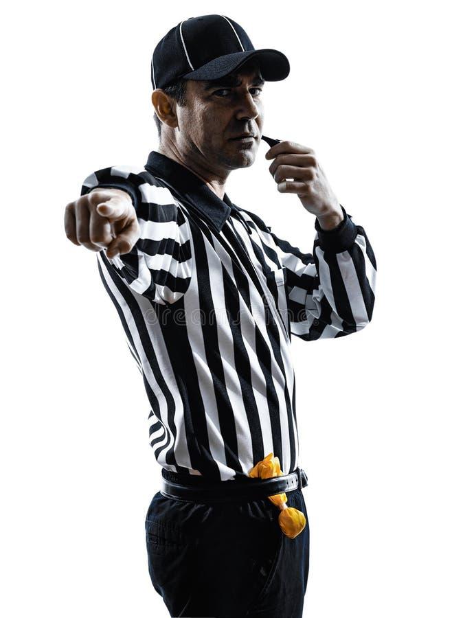 Силуэт рефери американского футбола свистя стоковые фото