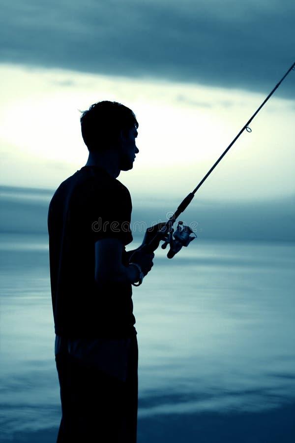 Силуэт рыболова стоковые фото