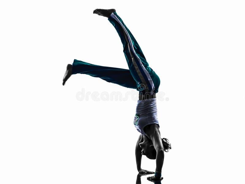 Силуэт танцев танцора capoeira женщины стоковые изображения