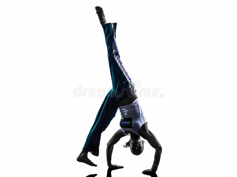 Силуэт танцев танцора capoeira женщины стоковое изображение rf