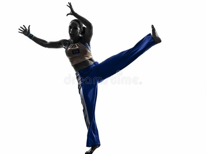 Силуэт танцев танцора capoeira женщины стоковое фото rf