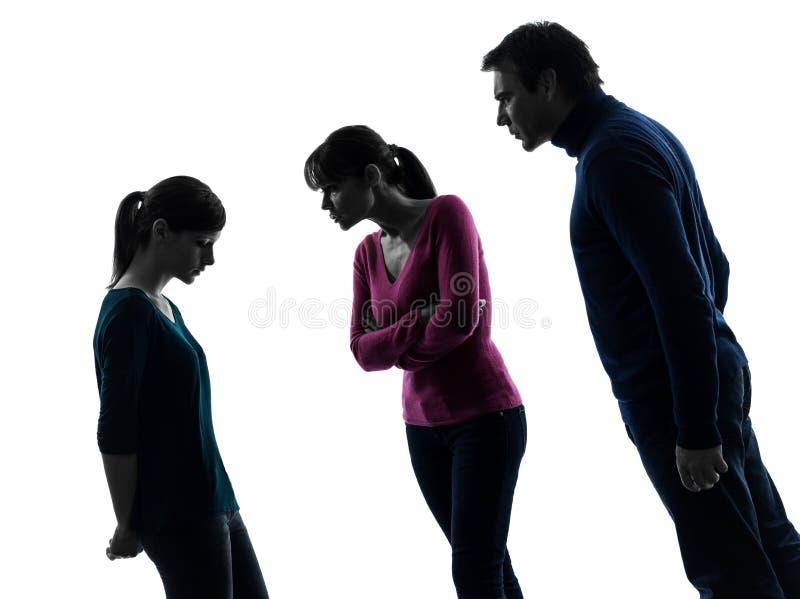 Силуэт упрека спора дочери матери отца семьи стоковое фото