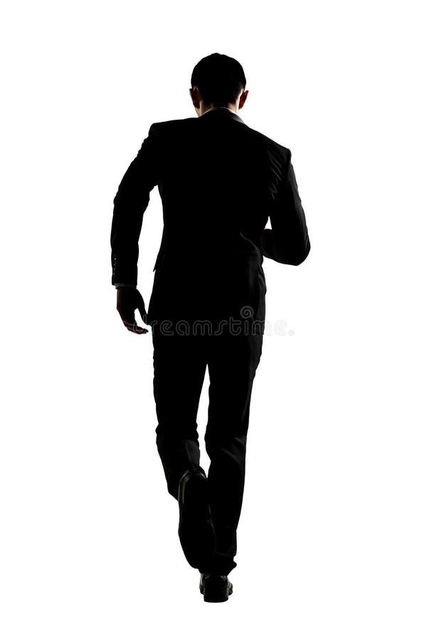 Силуэт хода бизнесмена стоковая фотография