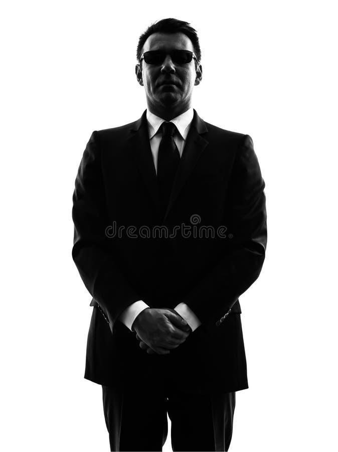 Силуэт человека агента телохранителя безопасностью секретной службы стоковая фотография