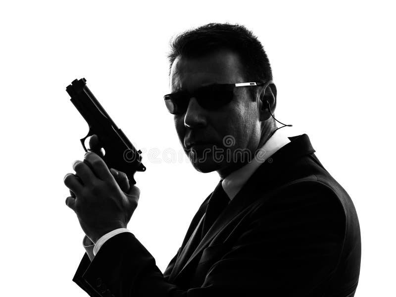 Силуэт человека агента телохранителя безопасностью секретной службы стоковое изображение rf