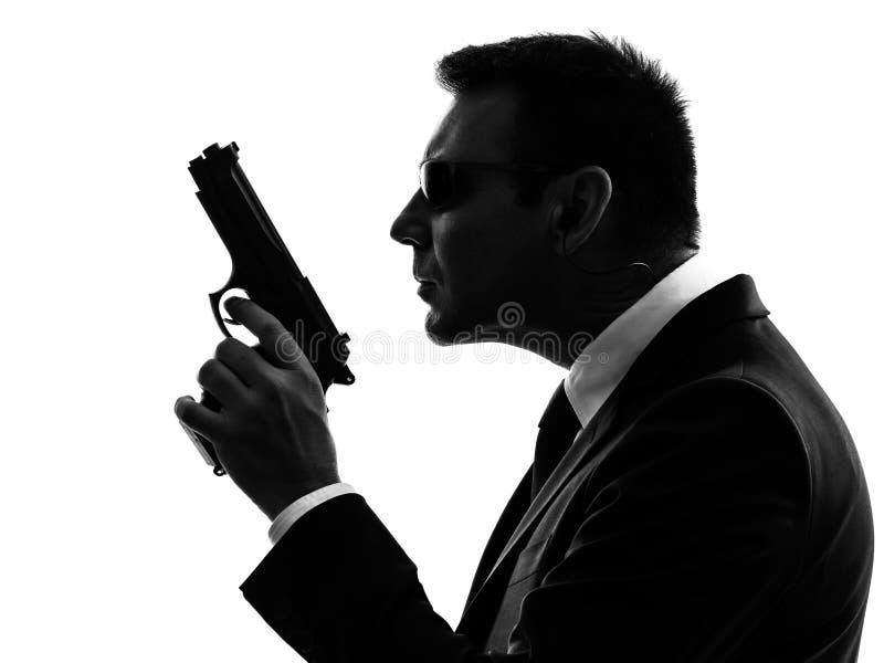 Силуэт человека агента телохранителя безопасностью секретной службы стоковое фото