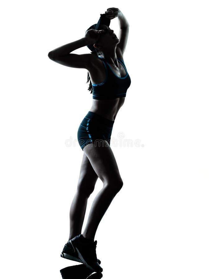 Силуэт jogger бегуна женщины утомленный затаивший дыхание стоковое фото rf