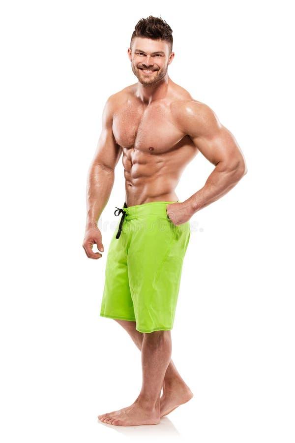 Сильный атлетический торс модели фитнеса человека показывая большие мышцы стоковые фотографии rf