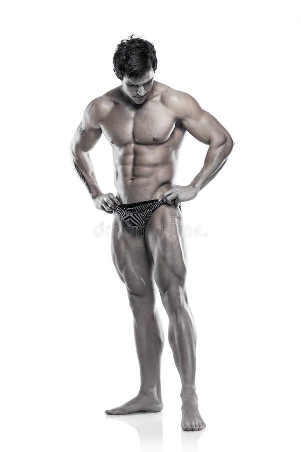 Сильный атлетический торс модели фитнеса человека показывая мышечное тело стоковое фото rf
