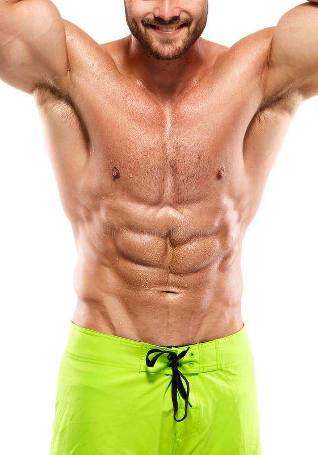 Сильный атлетический торс модели фитнеса человека показывая подбрюшную мышцу стоковая фотография