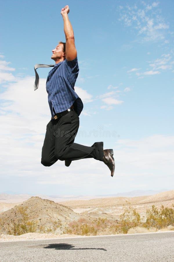 скакать бизнесмена воздуха excited счастливый стоковое изображение rf