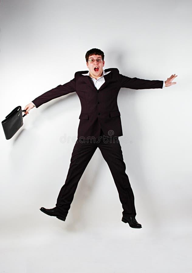 скакать бизнесмена стоковое фото