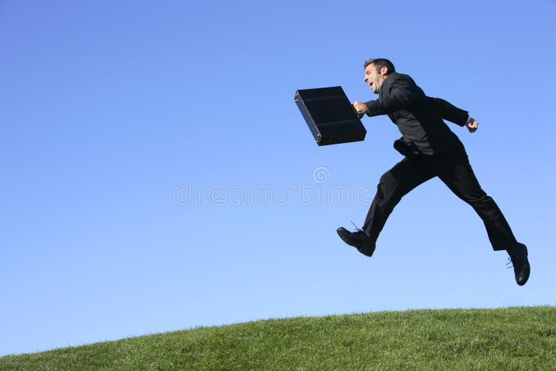 скакать бизнесмена стоковое изображение rf