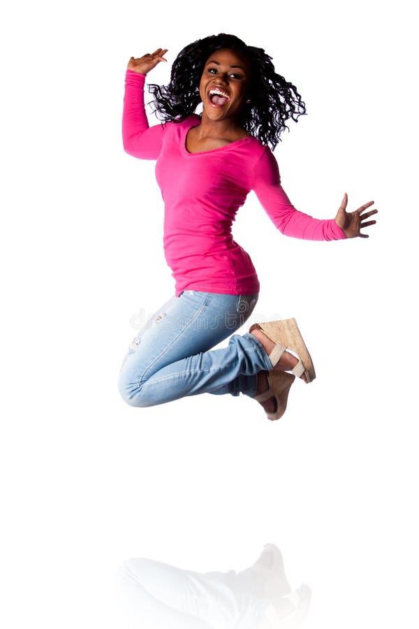 Скакать женщины счастья стоковая фотография rf