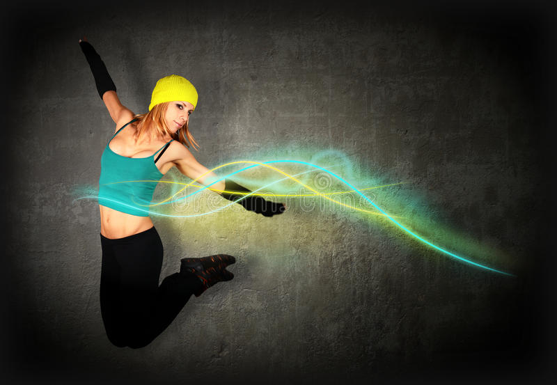 Скакать женщины/танцы с накаляя линиями стоковые изображения