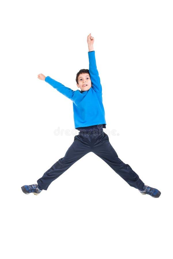 Скакать мальчика изолированный в белизне стоковое фото rf