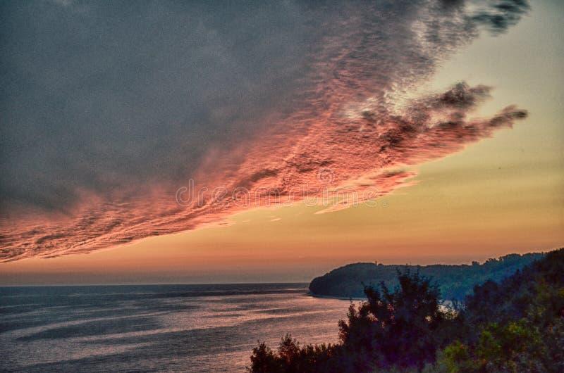 Скала Польша пляжа захода солнца стоковое изображение rf
