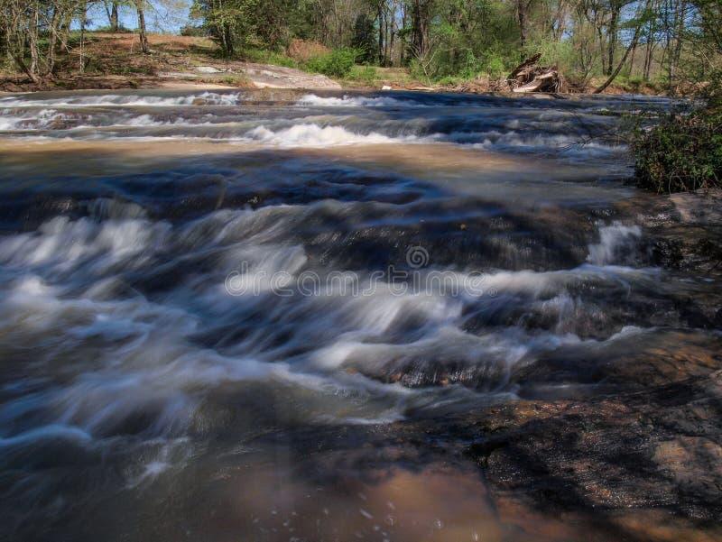 Скалистые мелководья над падениями Картера стоковое изображение