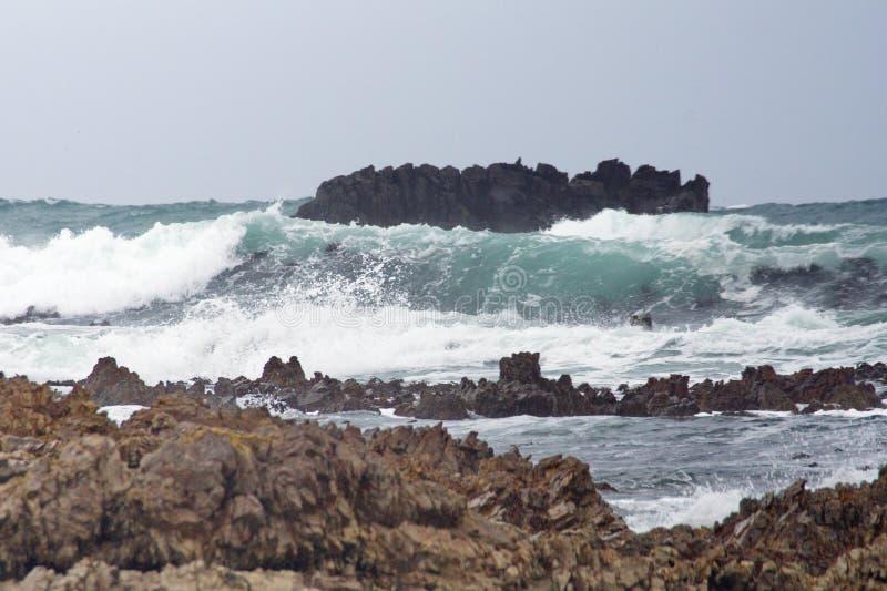 Скалистый островок с Kleinbaai стоковое изображение
