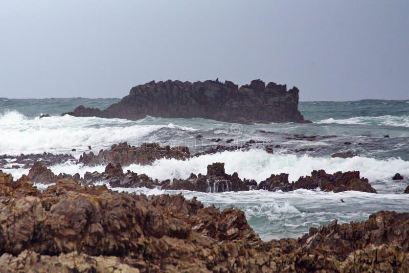 Скалистый островок с Kleinbaai стоковое фото rf