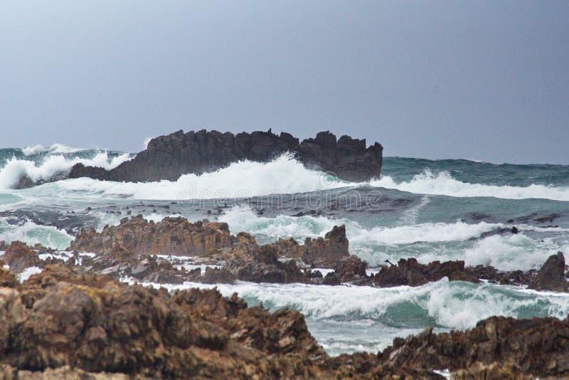 Скалистый островок с Kleinbaai стоковая фотография