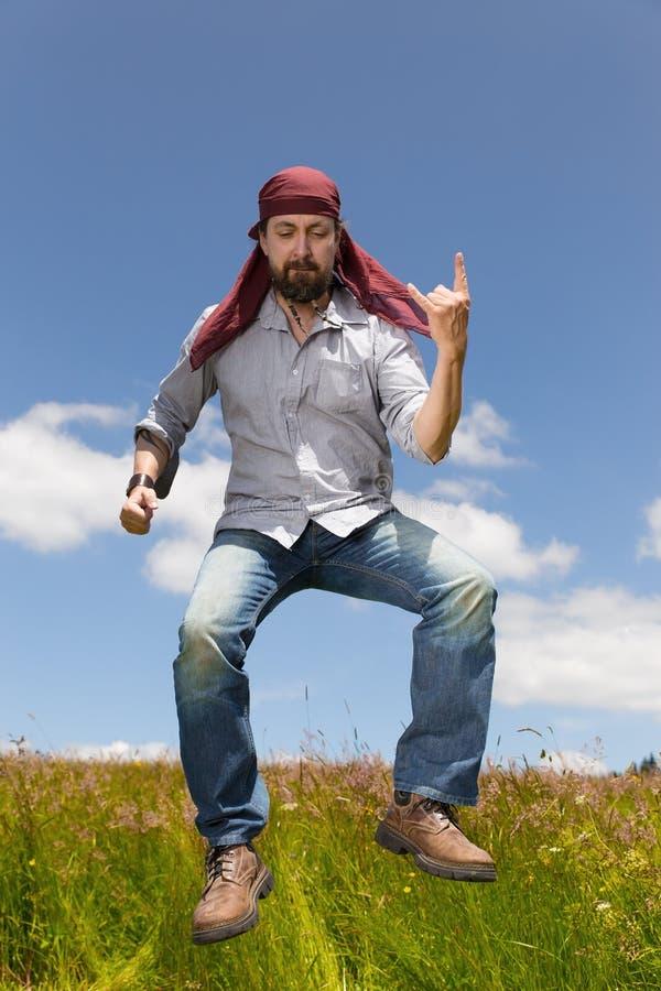 Download Скача человек формирует руку дьяволов Стоковое Изображение - изображение насчитывающей радостно, дьявол: 41663193