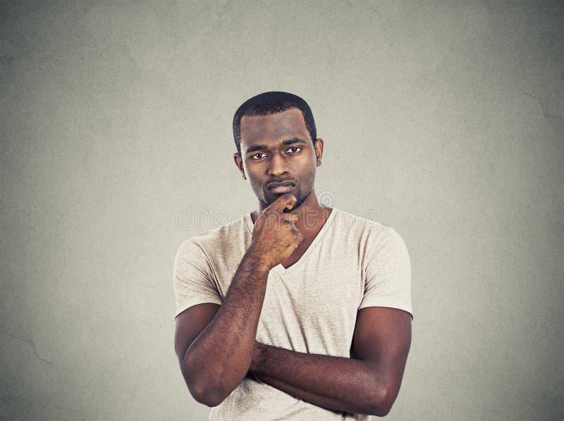 Скептичный молодой человек стоковое фото