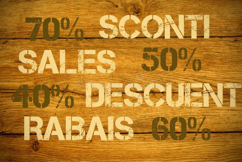 Скидки продаж в различных языках стоковые фотографии rf