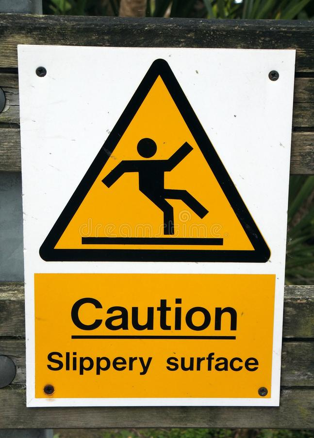 Скользкий поверхностный знак предосторежения стоковое изображение