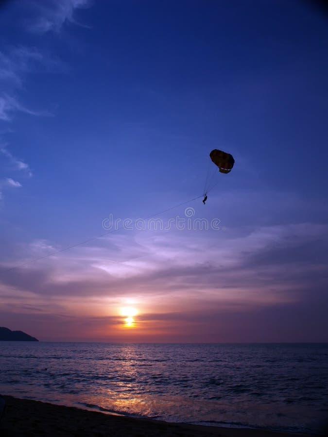 скользя заход солнца стоковое изображение
