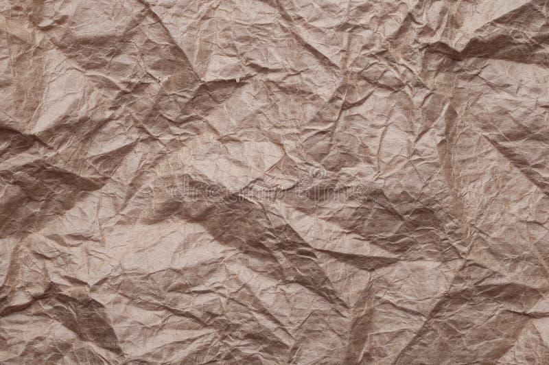 Скомканная бумага kraft Текстура скомкала повторно использованную старую коричневую бумагу стоковая фотография rf