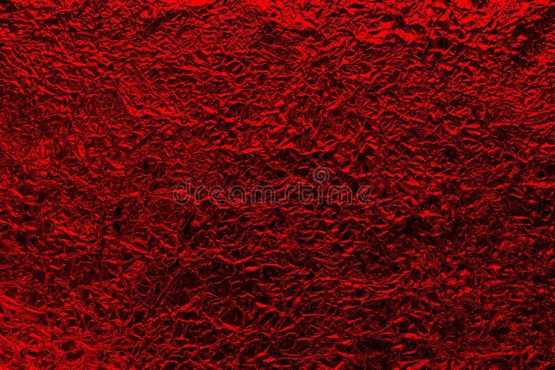 Скомканная предпосылка красного цвета фольги мягко яркая стоковое изображение