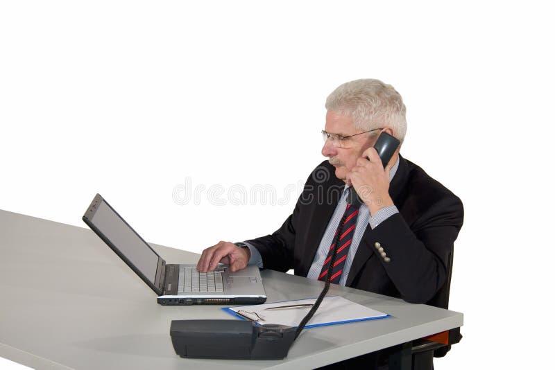 сконцентрированная деятельность менеджера старшая стоковые изображения rf